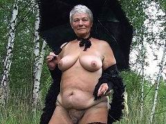 Gray hair village granny flashing in the forest